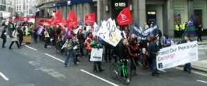 Striking public sector workers march past RBS in the City of London